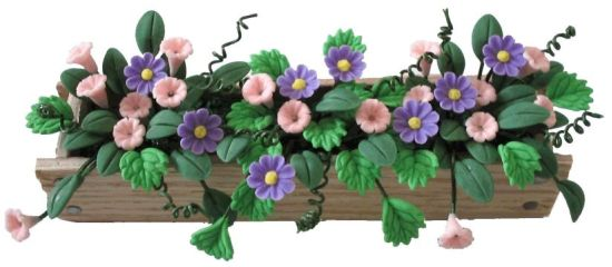 Pink and Purple Trumpet Flowers in Window Box