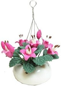 Pink Flowers Hanging in White Pot